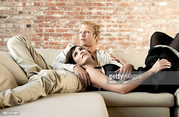 Caucasian couple relaxing together on sofa