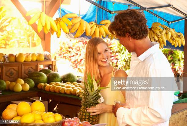 Caucasian couple shopping at produce stand