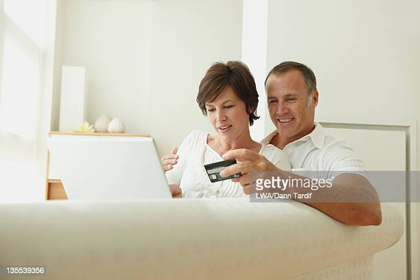 Caucasian couple shopping on line with credit card