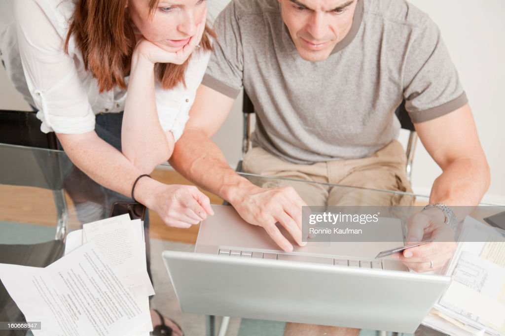 Caucasian couple shopping online with credit card : Stock Photo