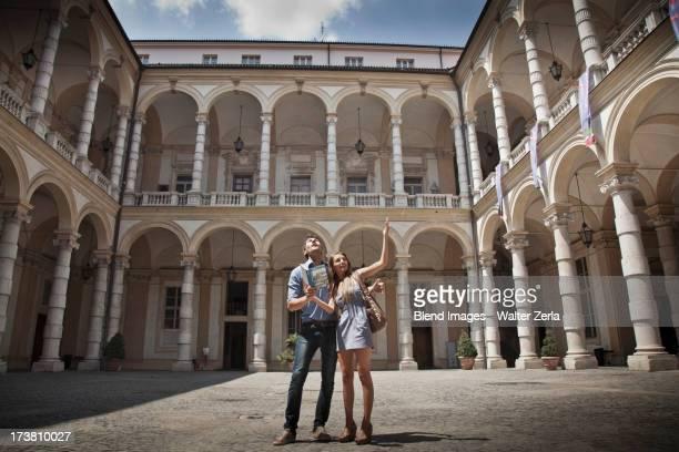 Caucasian couple sightseeing in plaza