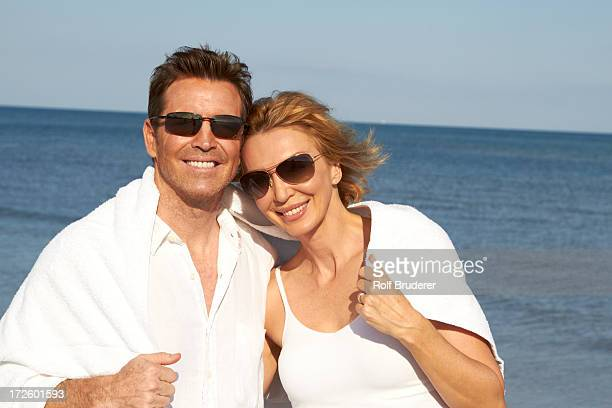 Caucasian couple smiling on beach