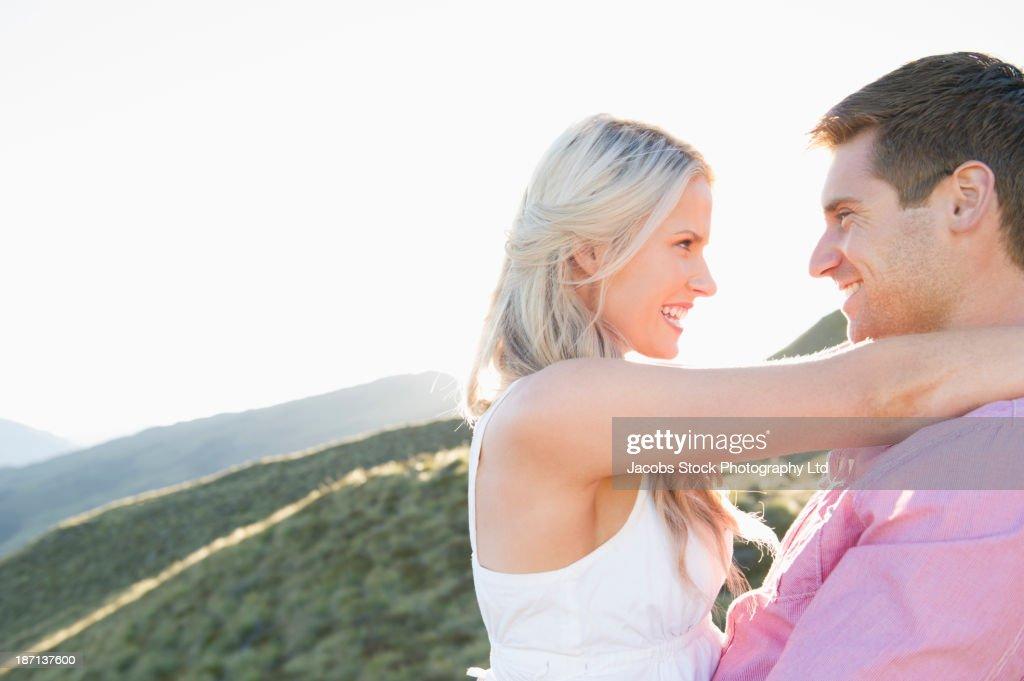 Caucasian couple smiling outdoors : Stock Photo