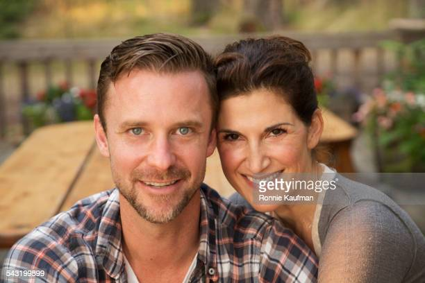 Caucasian couple smiling outdoors