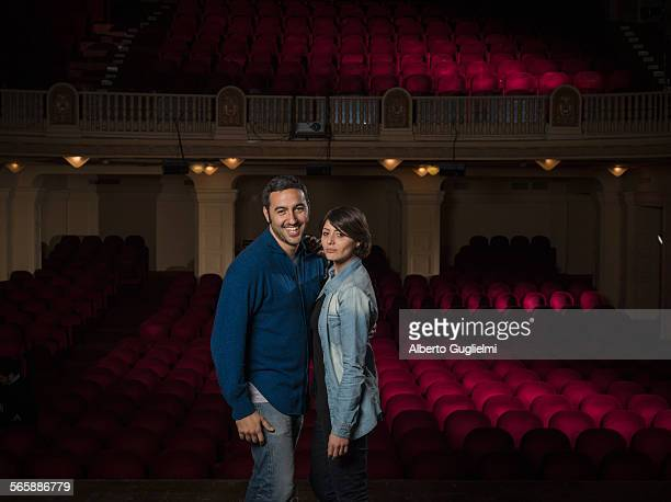 Caucasian couple standing in movie theater