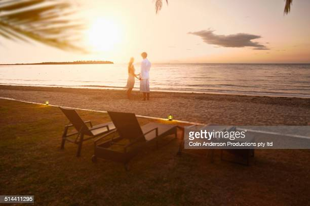 Caucasian couple standing on beach