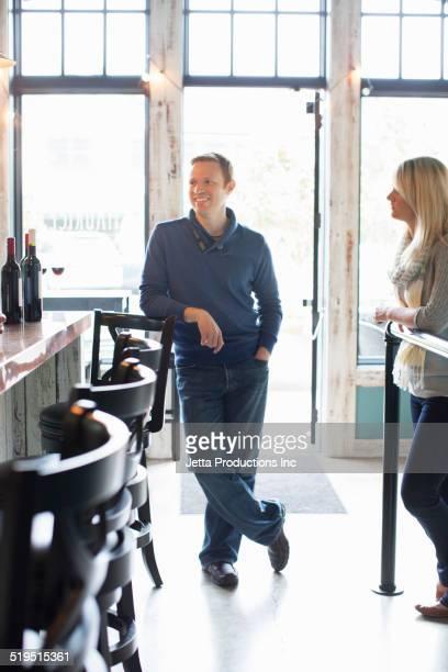 Caucasian couple talking at bar