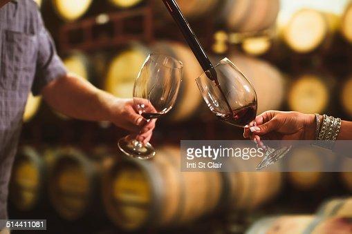 caucasian couple tasting wine in cellar stock photo getty im