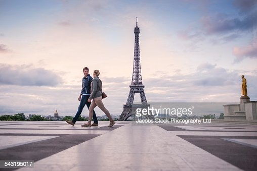 Caucasian couple walking near Eiffel Tower, Paris, France : Stock Photo