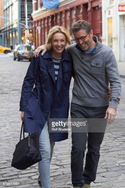 Caucasian couple walking on city street, New York City, New York, United States