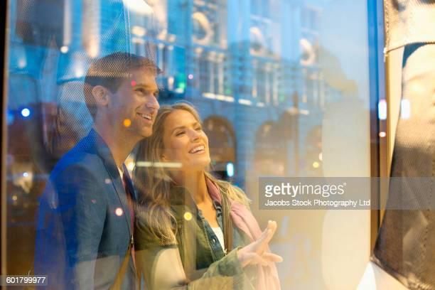 Caucasian couple window shopping