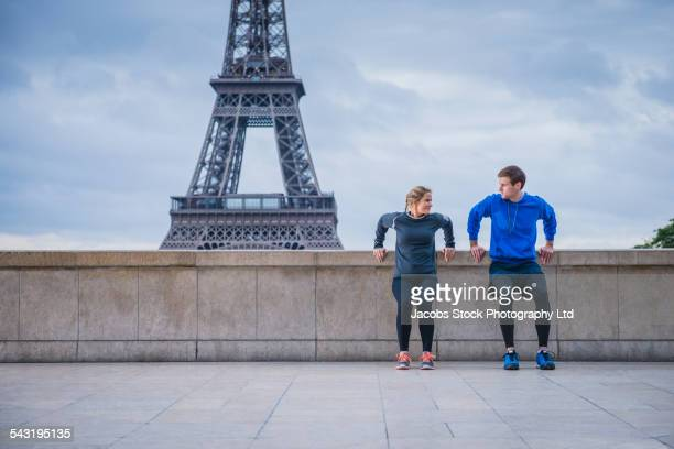 Caucasian couple working out near Eiffel Tower, Paris, France