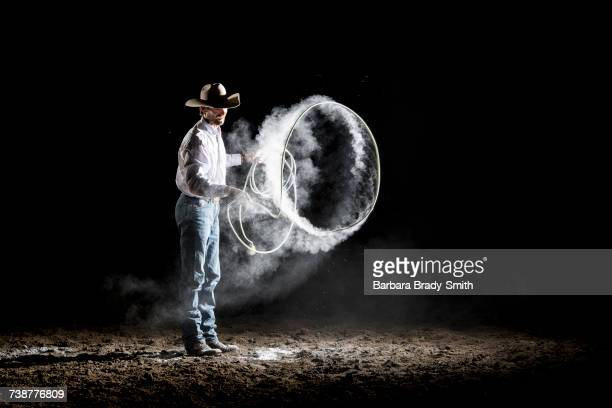 Caucasian cowboy spinning lasso