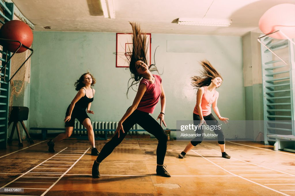 Caucasian dancers rehearsing in gym : Photo
