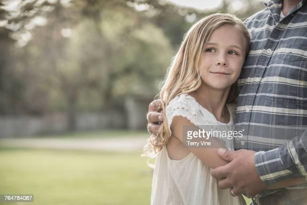 Caucasian daughter hugging father
