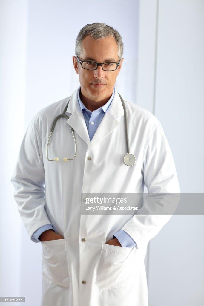 Caucasian doctor smiling in hospital