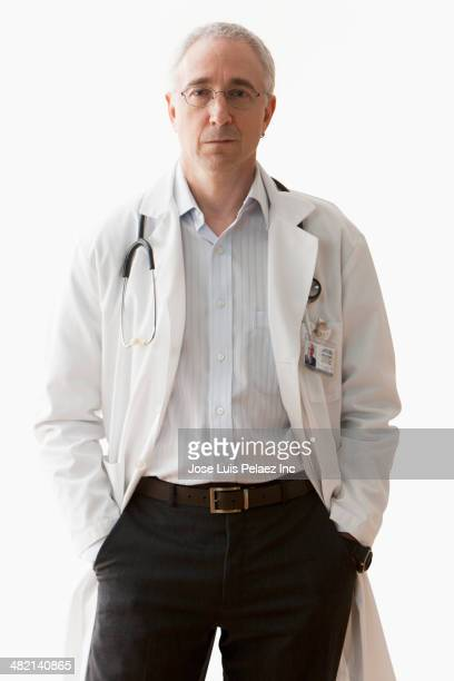 Caucasian doctor with hands in pockets