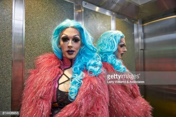 Caucasian drag queen posing in elevator