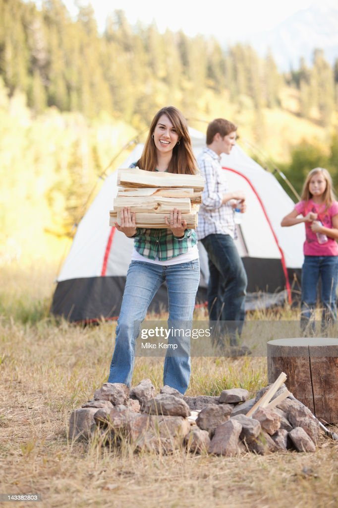 Caucasian family camping together : Stock Photo