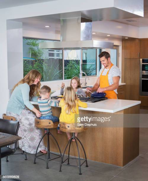 Caucasian family cooking in kitchen