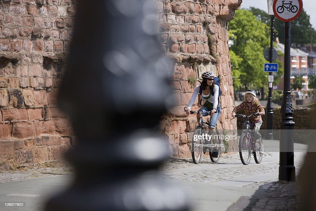 Caucasian family cycling in Chester, UK