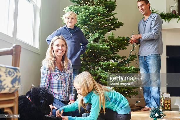 Caucasian family decorating Christmas tree