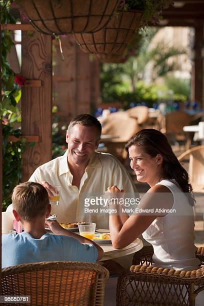 Caucasian family eating in restaurant