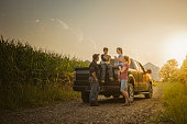 Caucasian family on truck on dirt road