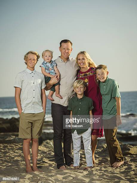 Caucasian family posing on beach