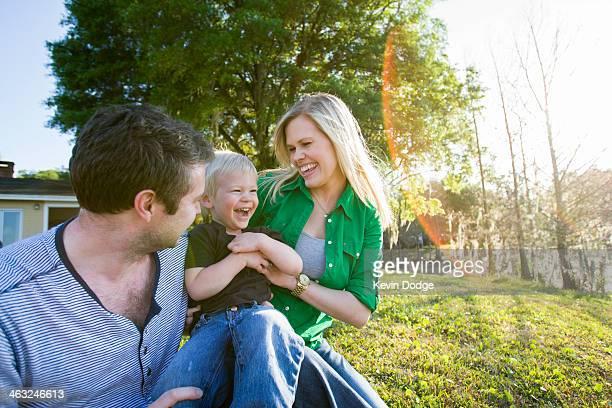 Caucasian family relaxing in backyard