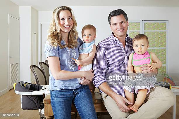 Caucasian family smiling in dining room