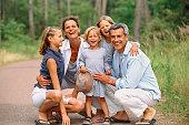 Caucasian family smiling in park