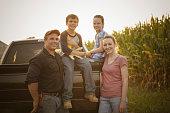 Caucasian family smiling on truck