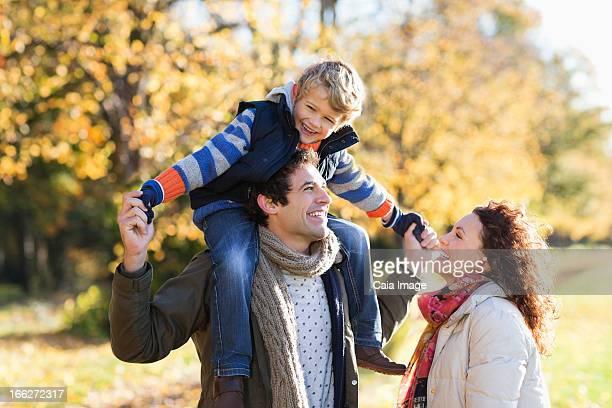 Caucasian family walking in park