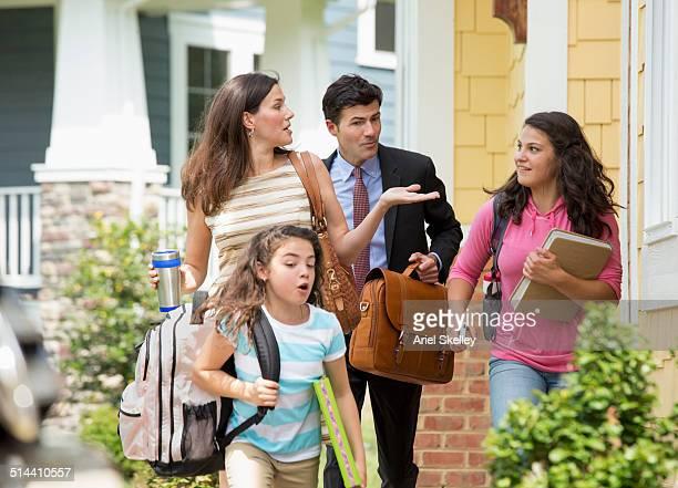 Caucasian family walking to car
