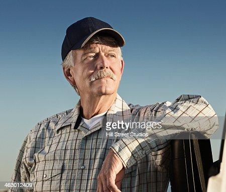 Caucasian farmer looking away