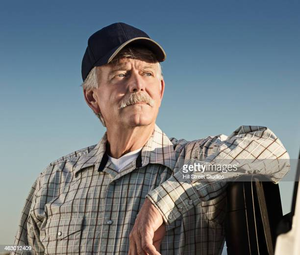 Caucasian farmer looking away