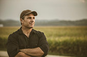 Caucasian farmer overlooking crop fields