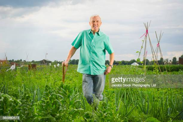 Caucasian farmer standing in farm field