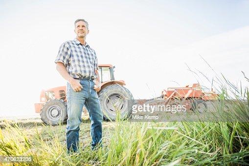 Caucasian farmer standing in field