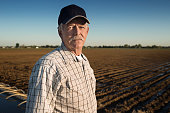 Caucasian farmer standing in irrigated field