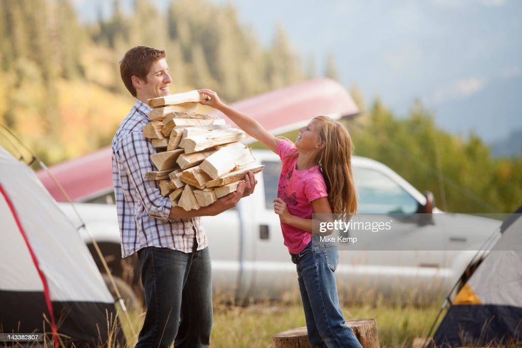 Caucasian father and daughter gathering firewood : Stock Photo