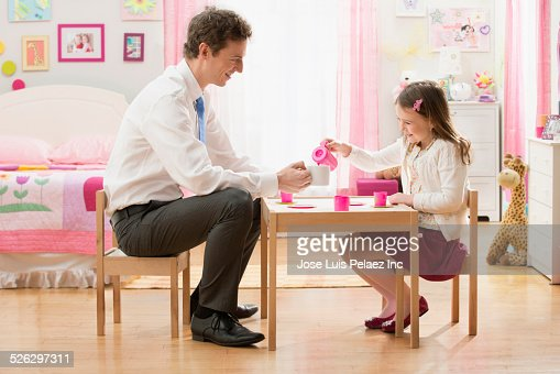 and daughter having tea party in bedroom stock photo getty images