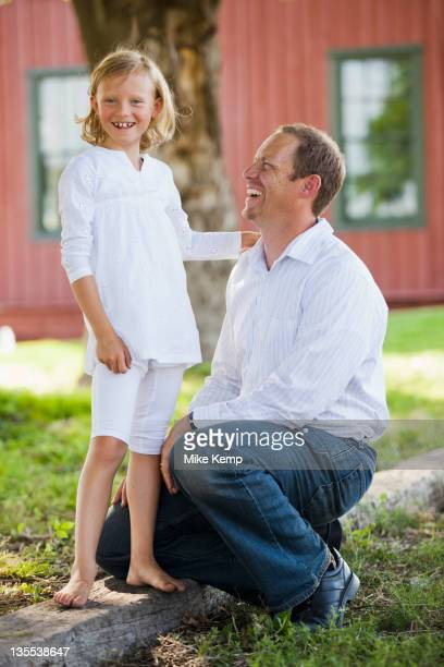 Caucasian father and daughter outdoors together