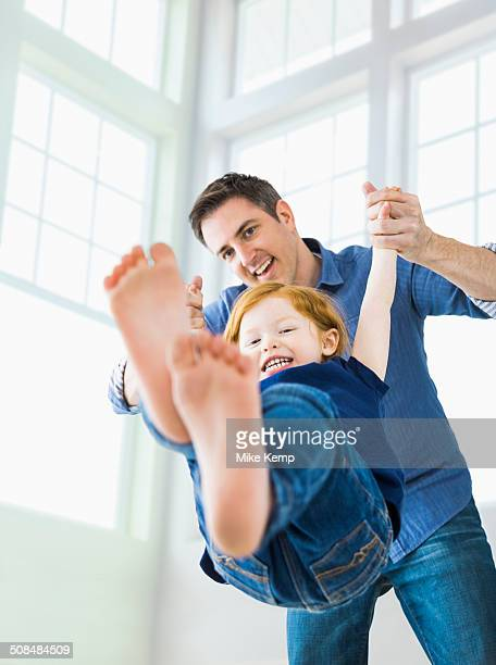 Caucasian father and daughter playing