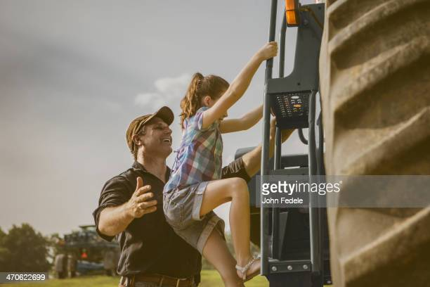 Caucasian father and daughter working on farm