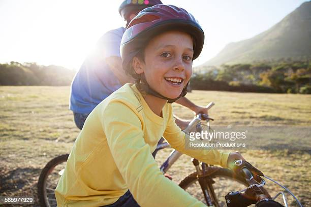 Caucasian father and son riding bicycles