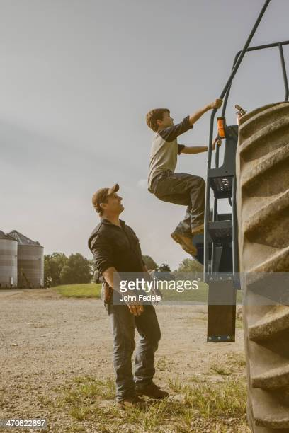 Caucasian father and son working on farm