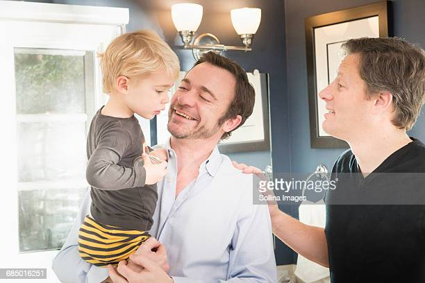 Caucasian fathers comforting son