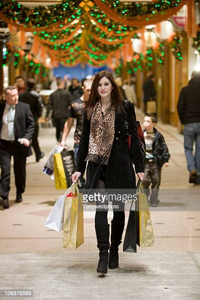 Caucasian female (20's) christmas shopping in Manchester UK